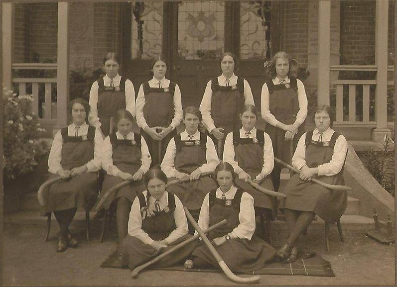 Annie Bain, ? seated on chair 2nd from left