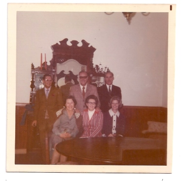 Dr Roux, Bert Badenhorst, Dad - Mrs Roux, Mom, Margie Badenhorst - In the dining room at home 95 Stuart Street Harrismith. Musta been going out: No grub on the table.